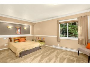 The bedroom is extremely large and could accommodate a desk as w
