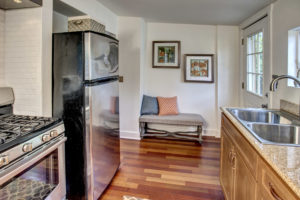 The gas range stove and subway tile reminds everyone who walks into this home of how Ballard was once a fishing village. Put on a cup of coffee and soak in the early 1900s vibe of this cottage.