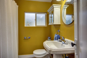 Super bright and energetic bath showcases the vintage details of the original architecture.