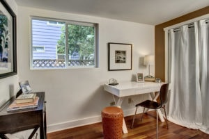 The second main level bedroom is a super bright home office, studio space, or a spot to catch up on your reading.