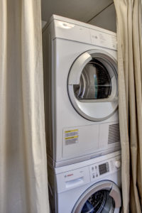 Home boasts a full size energy efficient washer and dryer just off the kitchen.