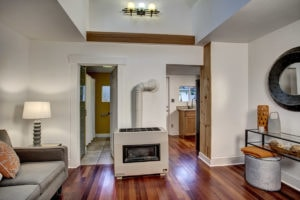 The vaulted ceilings and stunning wood detailing in the main living area makes one catch their breath at the well thought out renovation. Uses vertical space to make the home live larger.