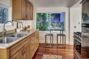 Kitchen overlooks an adorable side yard and neighbors HUGE vegetable garden.