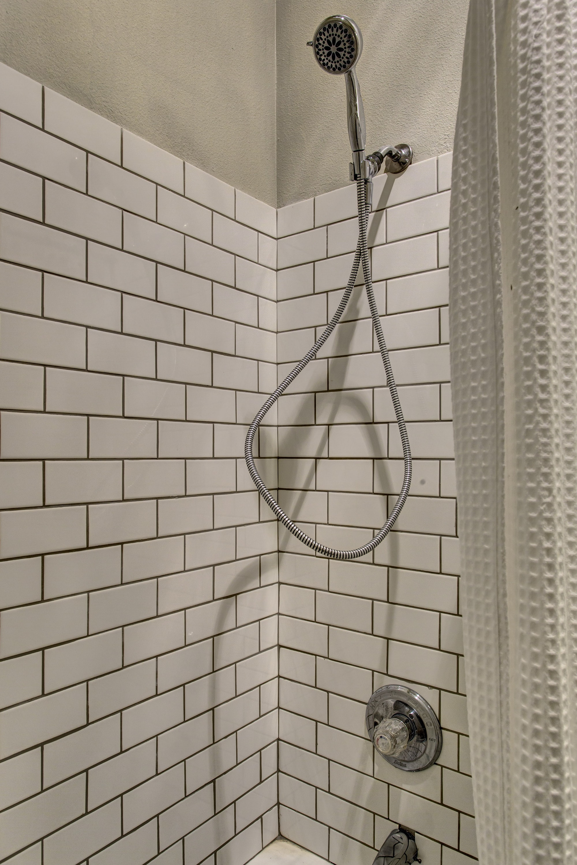 Beautiful subway tile in the shower.