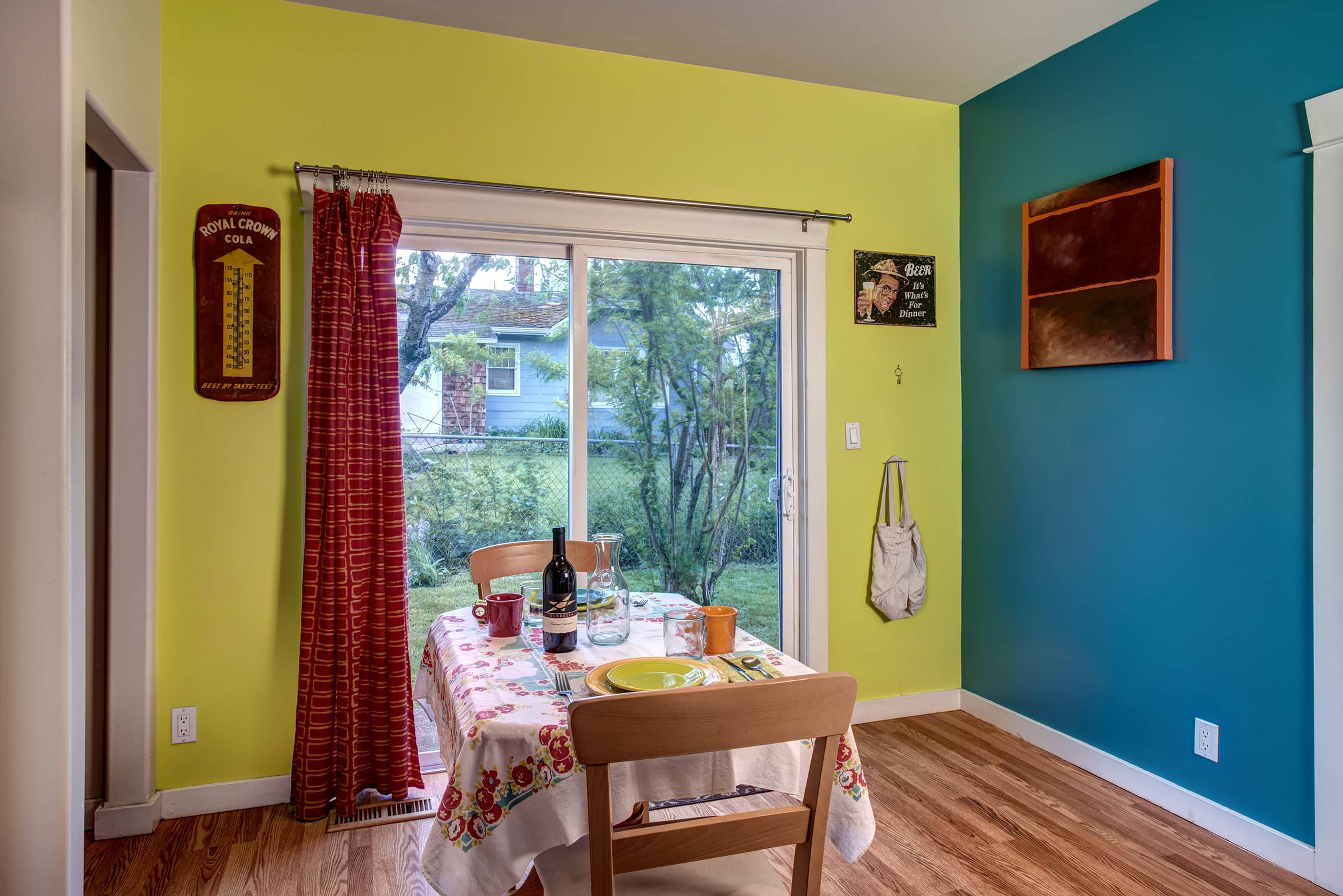 Check out this cute eat in kitchen with sliding doors to the yard.