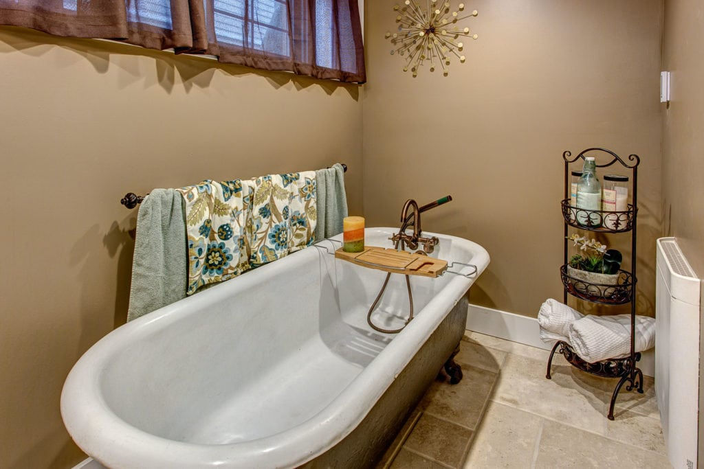The downstairs bathroom has been renovated to include a stunning clawfoot bathtub.