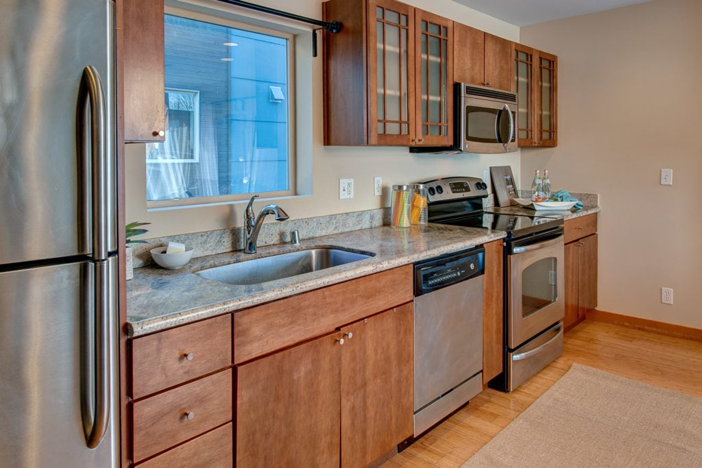 Granite Countertops and Stainless Steel Kitchen