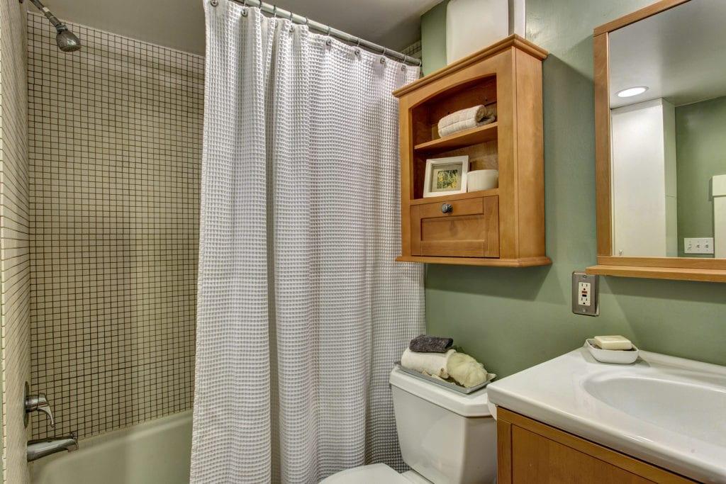 Raised bathroom with closet space & storage.