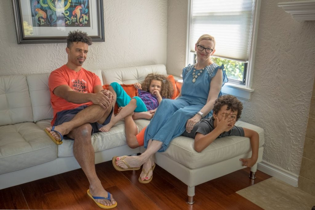 Seattle Home Buyer Stories: Rebecca and Iroro and family chill on the couch