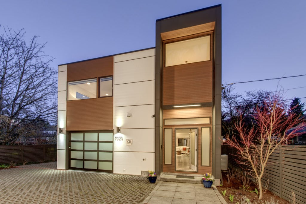 We Captured the Grandeur of this Unique Modern Maple Leaf Home by Photographing it During the Evening