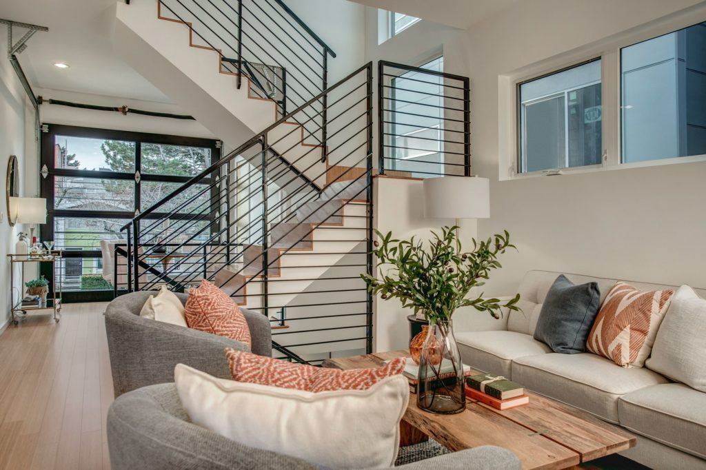The central handcrafted steel staircase is a key architectural point of the home.