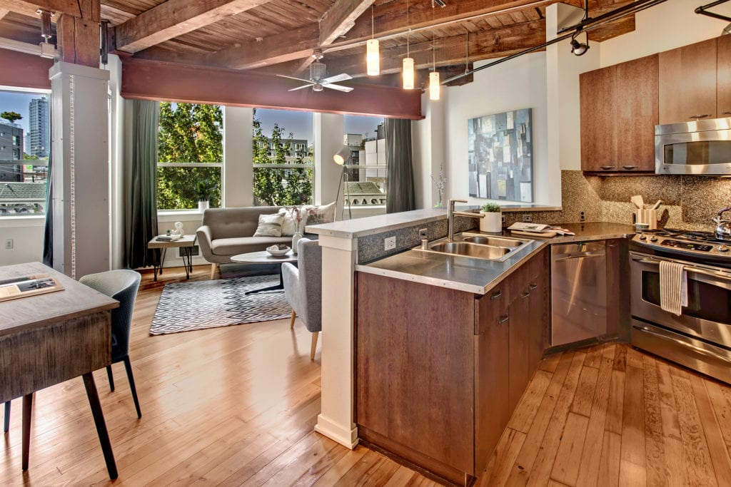 Capitol Hill Loft Condo Open Living Area and Stainless Steel Kitchen