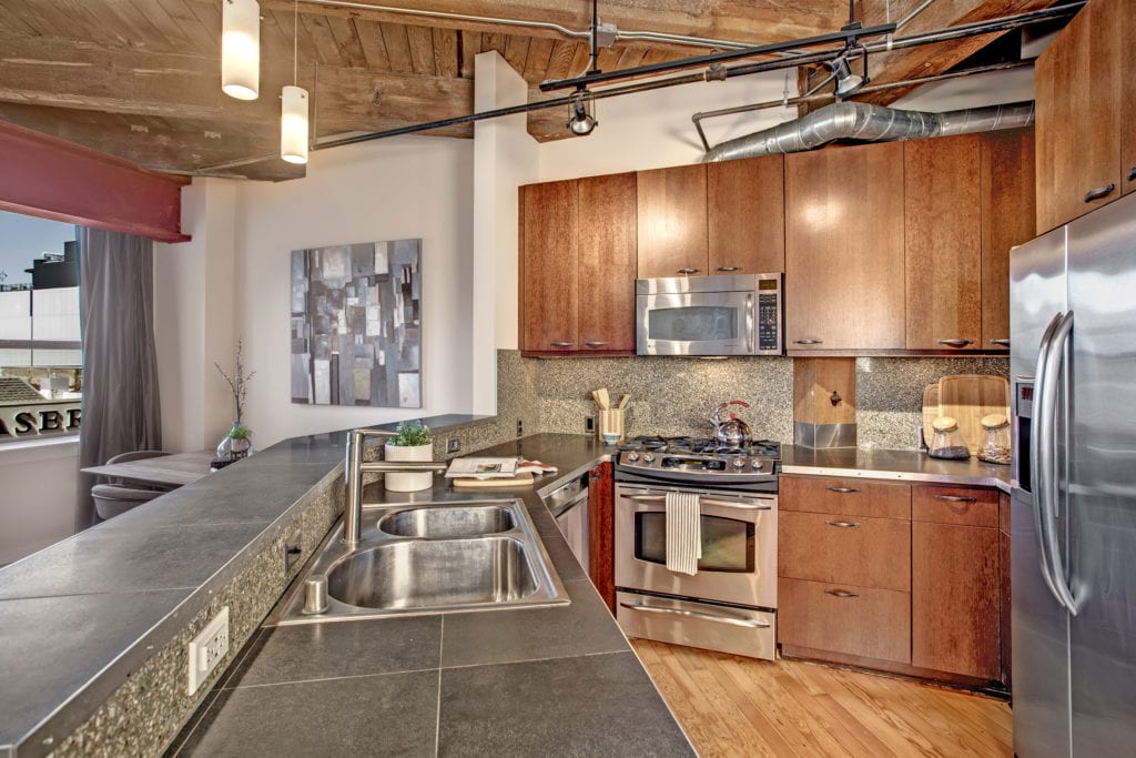 Capitol Hill Loft Condo Dining Area and Stainless Steel Kitchen
