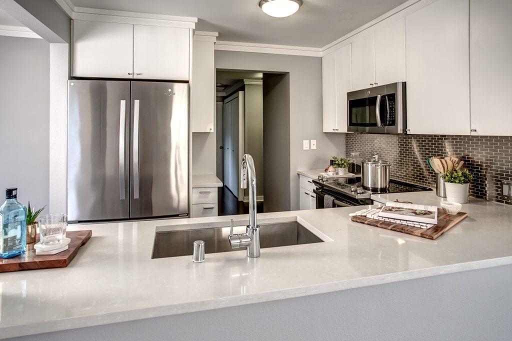 Modern Capitol Hill Condo, Midtown Seattle Condo, Top Floor Condo, Corner Unit Condo, Stainless Steel Kitchen, Bedroom Hallway, Laundry Closet