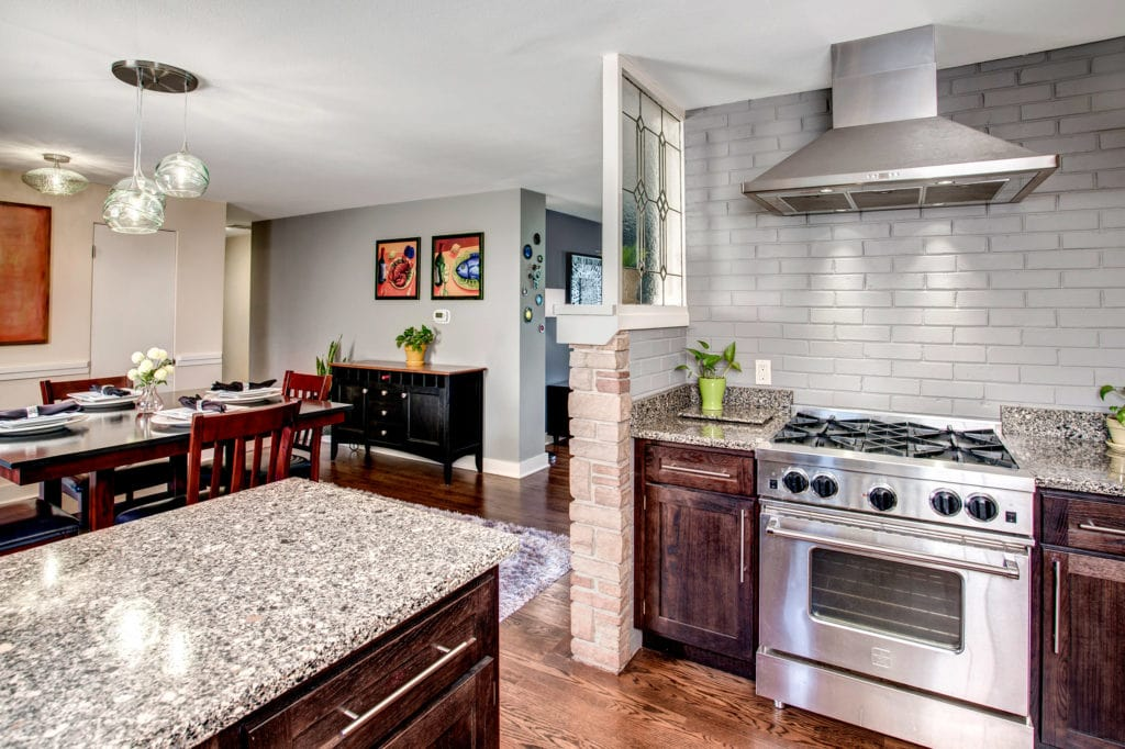 Mid-Century Meadowbrook Home Kitchen, Stainless Steel Appliances, Dining Area