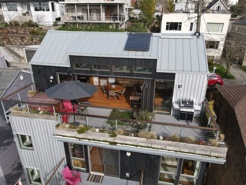 Modern Queen Anne View Home Drone Aerial Rooftop Deck Dining Area Nano Doors Hot Tub Rooftop Garden