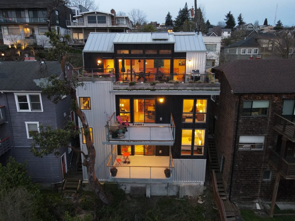 Modern-Queen-Anne-View-Home-Drone-Aerial-Twilight-View-Rooftop-Deck-Top-Floor-Open-Living-Area-Private-Decks-Hot-Tub-Rental-Suite-Home-Office-Owners-Room